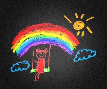 Very happy girl with rainbow and sun