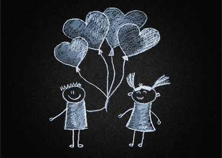 Happy couple with heart shaped balloon. Blackboard or asphalt drawing photo