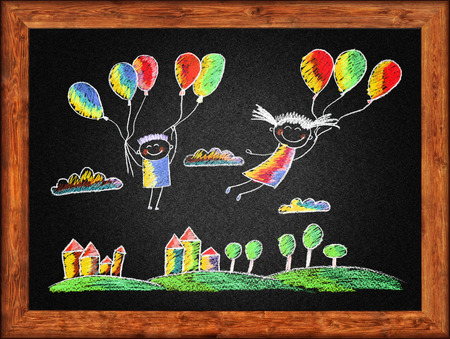 chalks: Black blackboard with frame and kids drawing. Color chalks