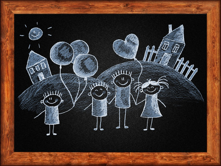 Black blackboard with frame and kids drawing. White chalks photo
