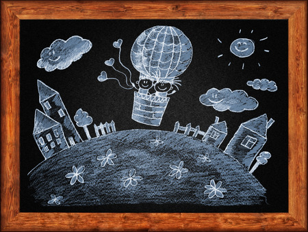 chalks: Black blackboard with frame and kids drawing. White chalks Stock Photo
