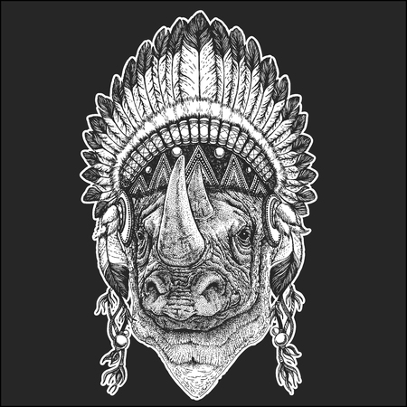 Rhinoceros, rhino Cool animal wearing native american Indian headdress with feathers Boho chic style. Hand drawn image for tattoo, emblem, badge, icon, patch.