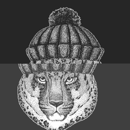 Leopard, jaguar face. Winter knitted hat. Portrait of wild animal.