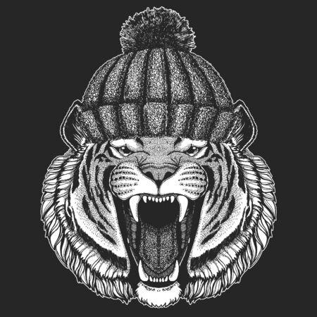 Tiger portrait. Winter knitted hat. Wild cat head.