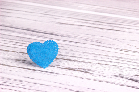 corazones azules: Light Blue heart of felt on a white gray wooden background. Valentine Day.Greeting card.Wedding