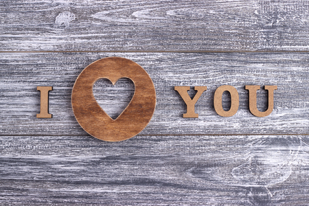 I love you, wooden lettering, gray wooden background, postcard Happy Valentine day, flat lay,wedding Stock Photo