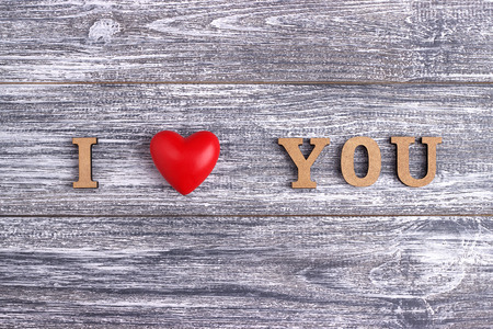 I love you, wooden with red heart lettering, gray wooden background, postcard Happy Valentine day, flat lay Stock Photo