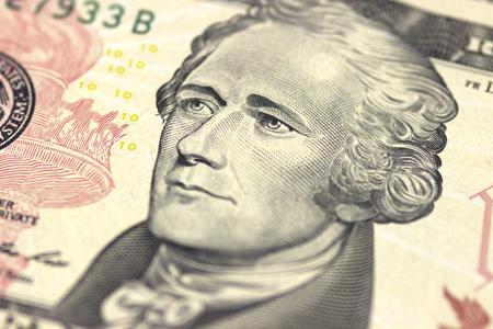 Alexander Hamilton face on US ten or 10 dollars bill macro, united states money closeup