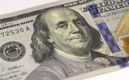 Benjamin Franklin face on US hundred or 100 dollars bill macro, united states money closeup