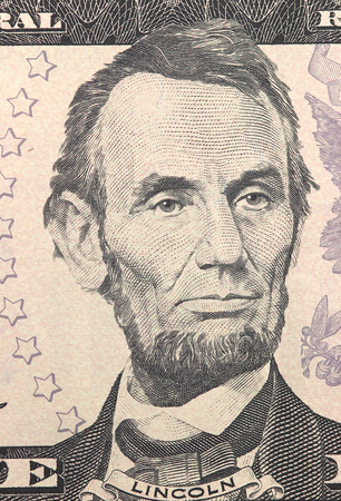 honest abe: Abraham Lincoln face on US five or 5 dollars bill macro, united states money closeup