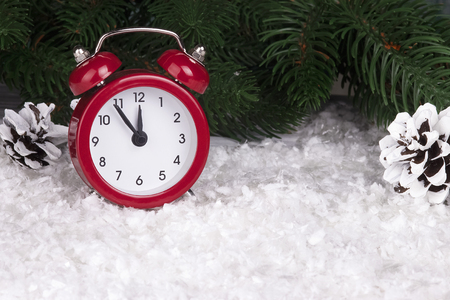 Christmas background with red alarm clock snowflakes cones and cones