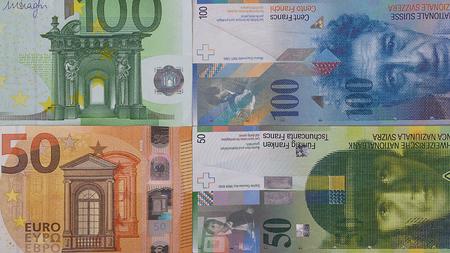 100 euro 50 swiss franc money background