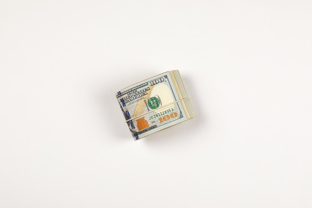 Stack of USA 100 dollars isolated on white background