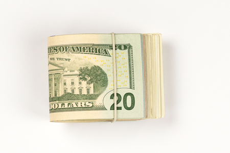 Stack of USA 20 dollars isolated on white background