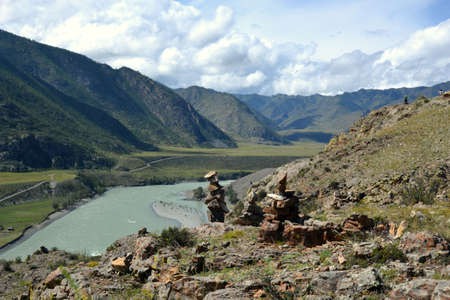 shamanic: Mountains Of Altai  Shamanic pyramid on the background of the river Katun