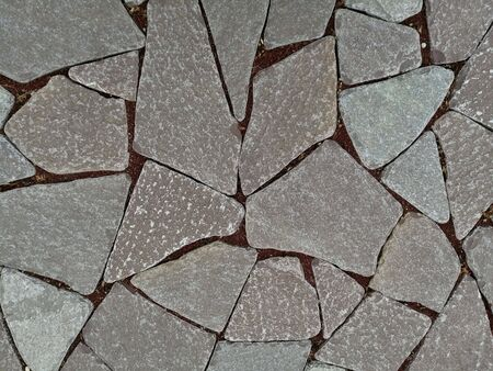 Flat stones and red granite chips between on the ground Reklamní fotografie