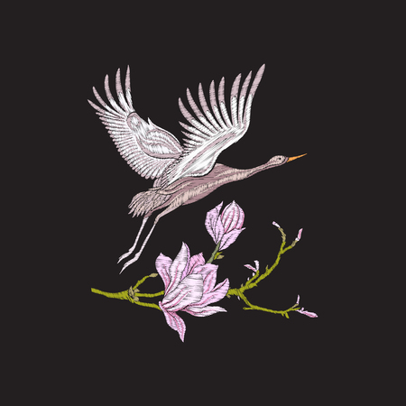 Embroidery flowers and crane on black background.
