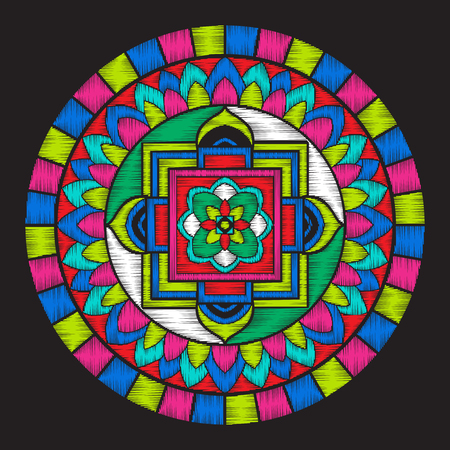 Embroidery with tibet mandala on black background.