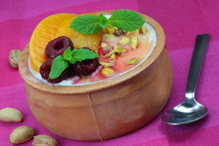 Greek yoghurt with honey, nuts and fresh fruit Stock Photo - 11001522