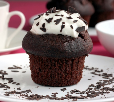 cup cakes: Chocolate muffin with cream Stock Photo