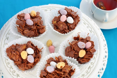 cornflakes: Easter chocolate crispy cakes with a cup of tea Stock Photo