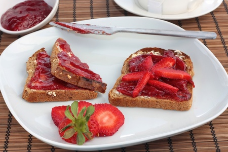 Luxury breakfast of toast with strawberry jelly and fresh strawberries photo