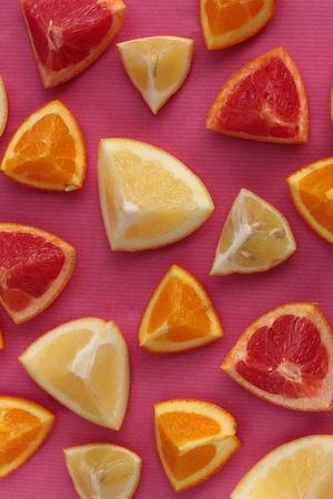 Citrus fruits background including lemons, oranges, limes, grapefruit and pink grapefruit