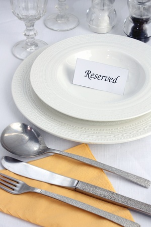 reserved: Restaurant table reservation Stock Photo