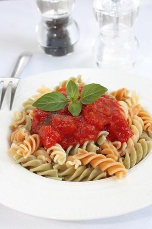 Fusilli pasta with tomato sauce Stock Photo