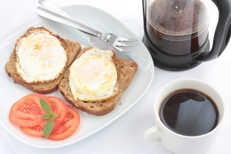Breakfast of eggs on toast with French coffee