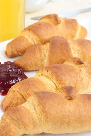 A breakfast of croissants with jam and orange juice Stock Photo