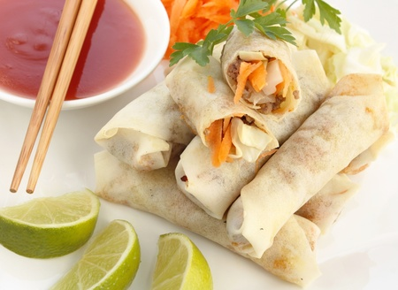 close-up of spring rolls with sweet and sour sauce  photo