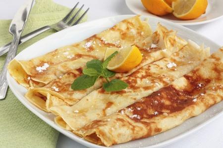 crepes: Sugar and lemon pancakes