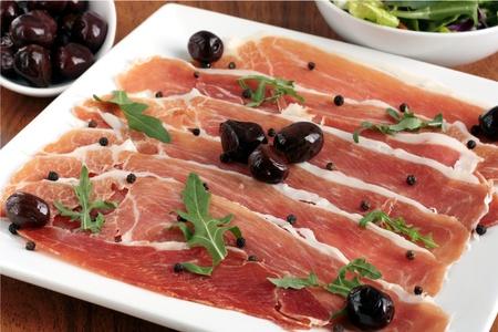 Serrano ham appetizer Stock Photo