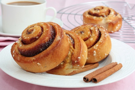 roll: Cinnamon rolls and a cup of coffee