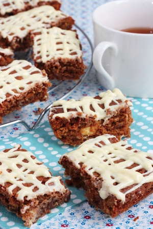 Homemade brownies or cake bars with a cup of tea photo