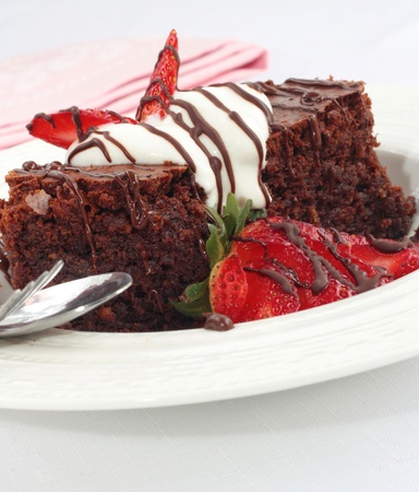 brownie: Chocolate brownies with cream and fresh strawberries Stock Photo