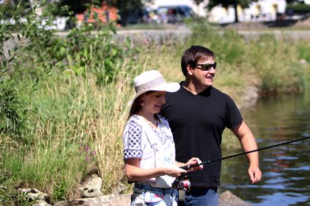 sportfishing: Woman and man by sportfishing