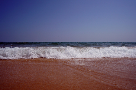 Lonely Atlantic beach in spring in Portugal with light swell