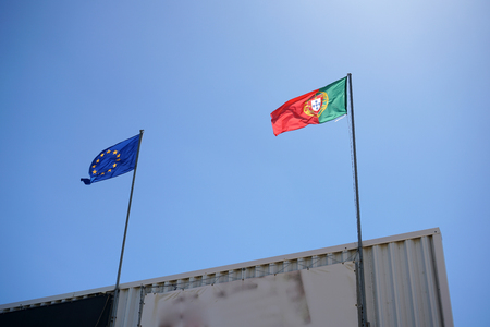 Portuguese and European flag on a building in the Algarve