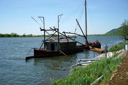 One of the last big professional fishermen ships on the Danube near Regensburg in Germany
