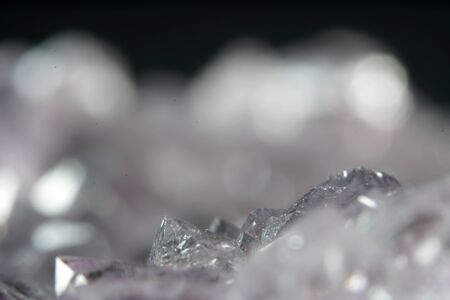 Quartz also called deep quartz photographed in studio in front of black background in Marco mode Stock Photo