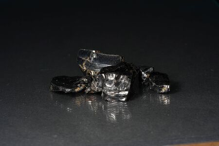 Shungit is a black rock that consists mainly of carbon and was photographed in top quality and studio quality.