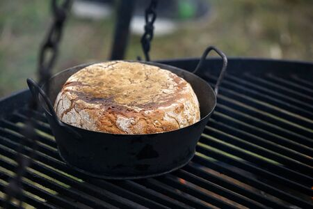 Freshly baked bread baked in a wood oven according to an old recipe wood stove Banque d'images - 138374231
