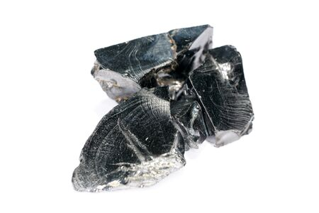 A black rock also called healing stone shungite, which consists mainly of carbon was photographed here in top quality.