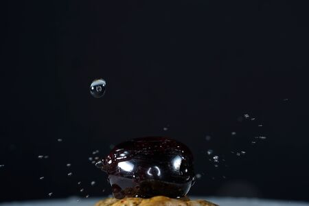 Drops photographed with higspeed flashes and dropper in the studio