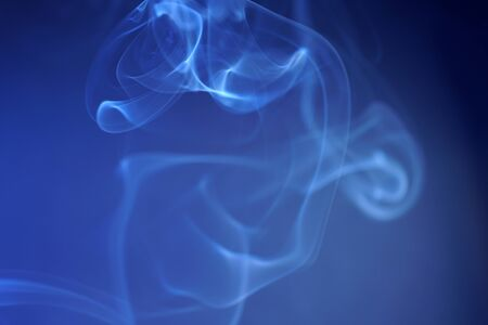 Smoke from an incense stick with color foils Photographed in the studio Banco de Imagens