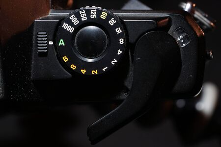 Film of an analogue camera with colorful background photographed in the studio Stockfoto