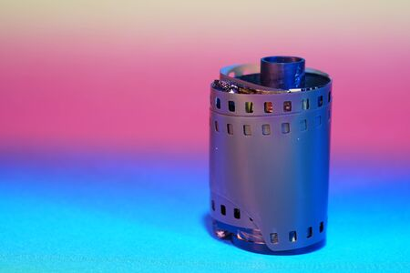 Film of an analogue camera with colorful background photographed in the studio