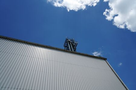 Factory barrels in industrial areas with aluminum as outer cladding photographed in summer